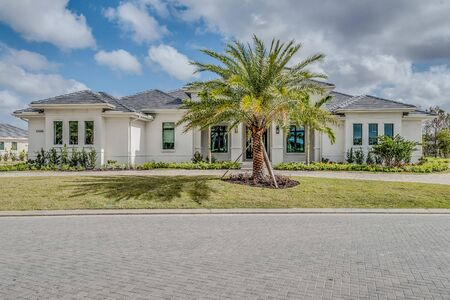 Photo for Large white Florida home with palm tree adorning the front yard - Royalty Free Image