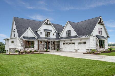 Photo for Beautiful modern farmhouse design with three car garage - Royalty Free Image