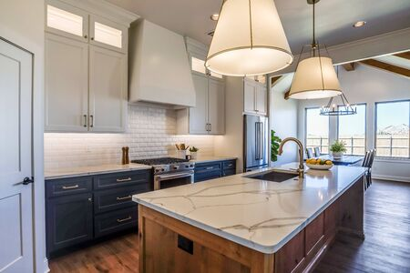 Photo pour Beautiful kitchen with floor to ceiling custom built cabinets and quartz countertops - image libre de droit