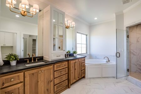 Photo for Magnificent garden tub and double vanity in newly built master suite - Royalty Free Image