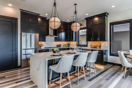 Photo pour Kitchens with multi-colored wood flooring - image libre de droit