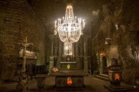 Chapel in the main hall in the Wieliczka Salt Mine (13th century), one of the world's oldest salt mines. Wieliczka, Poland.
