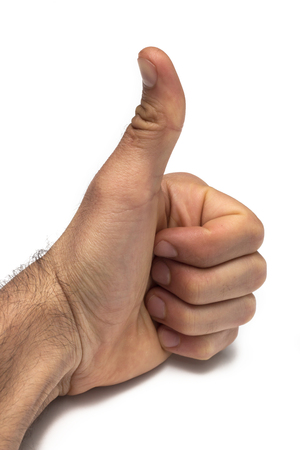 man hand is displaying a thumbs up, indicating that he likes or approves of something