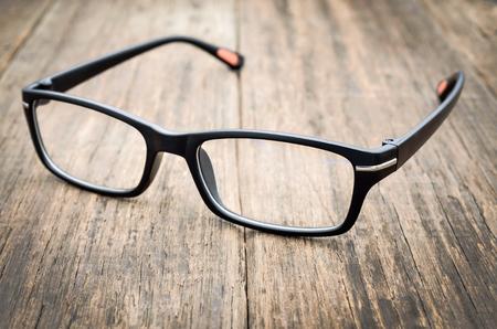 Photo pour Black eye glasses on wooden floor, Close up image - image libre de droit