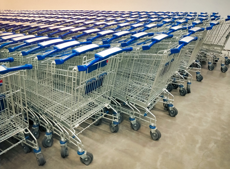 Rows of shopping carts collected in supermarket.
