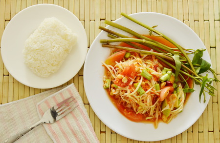 Somtum Thai green papaya salad tasted spicy sour and sweet eat couple with sticky rice