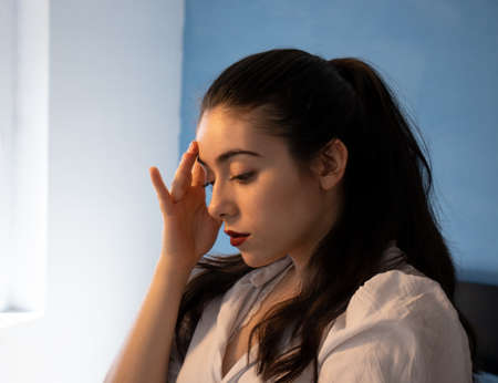 Photo for Woman with a disappointed face in front of the mirror - Royalty Free Image