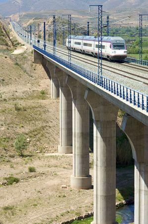 train running on a viaduct