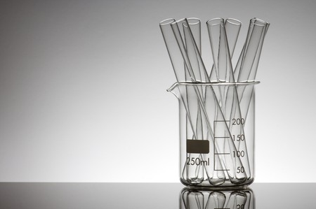 test tubes in a beaker with a white background