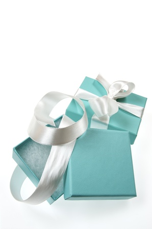 two small turquoise box tied with a white ribbon
