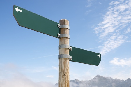view of two wooden directional signs on a pole