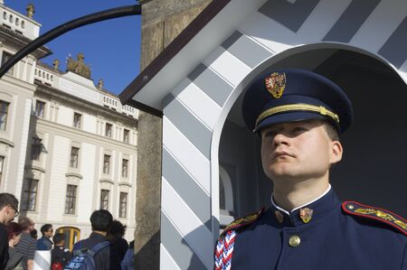 Prague, Czech Republic - October 12, 2008: A guard stands motionless at the entrance to Prague Castle, along with daily change of guard, this is one of the shows most popular with tourists