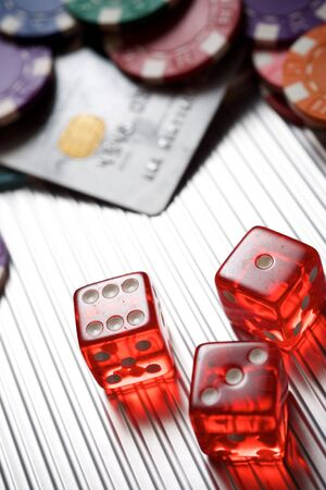 Photo pour Casino chips and dices on a metal surface. - image libre de droit