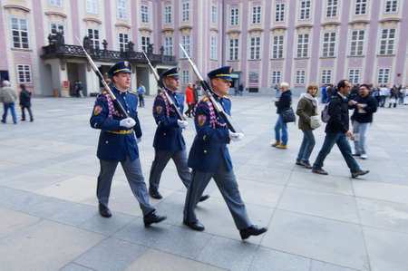 Prague, Czech Republic - October 12, 2008: Three uniformed guards parading in Prague Castle.