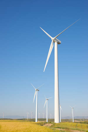 Photo for Windmills for electric power production, Zaragoza province, Aragon in Spain. - Royalty Free Image