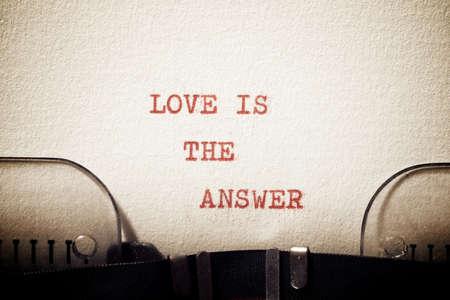 Foto de Love is the answer phrase written with a typewriter. - Imagen libre de derechos