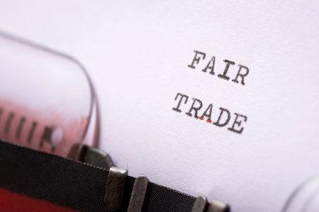Foto de Fair trade phrase written with a typewriter. - Imagen libre de derechos