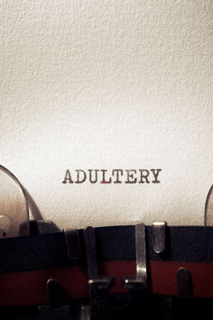 Photo pour Adultery word written with a typewriter. - image libre de droit