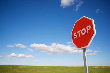 Photo pour Stop traffic sign with cloudy sky. - image libre de droit