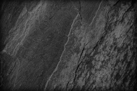 Foto de Dark grey black slate background or texture; Surface wall of stone wall dark grey tones for use as background, Stone texture background grunge nature detail for design and decor, construction, interior - Imagen libre de derechos