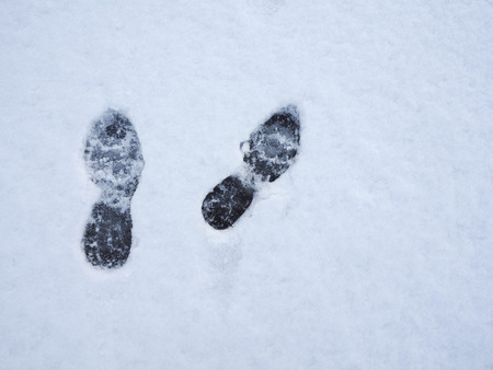 Footprints in fresh snow background. Top view.