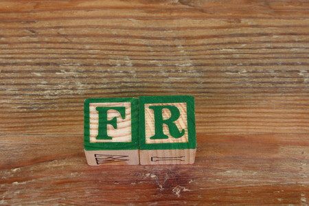 The term FR visually displayed using colorful wooden blocks
