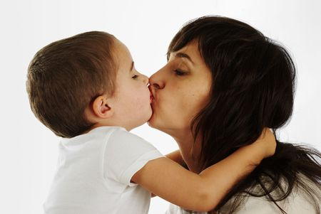 Mother and son gently kissing and hugging