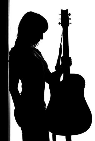 Silhouette of woman with guitar isolated on white