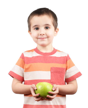 Photo pour Smiling boy with green apple isolated on white - image libre de droit