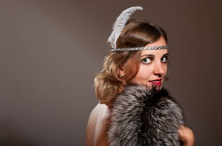 Retro woman with feather and fur turn around