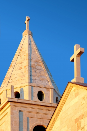 Detail of the tower of the parish church- Church of St  George  St Juraj church  Primosten Croatia