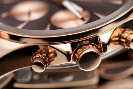 Close-up button gold wristwatches.