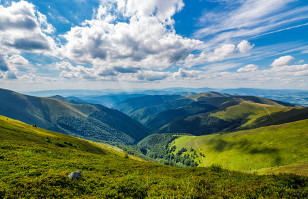 gorgeous cloudscape over the grassy hillside. gorgeous summer scenery in mountains