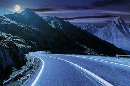 Photo pour road in mountains with rocky ridge in the distance at night in full moon light. composite image. travel by car concept - image libre de droit