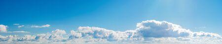 Photo pour amazing cloud formations on a bright blue sky. beautiful side lit cloudscape panorama in springtime - image libre de droit