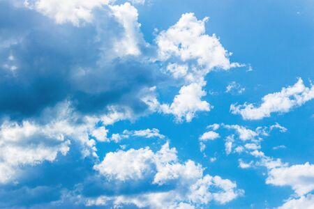 Photo pour azure sky with fluffy clouds. beautiful springtime nature background. dynamic side lit cloudscape - image libre de droit