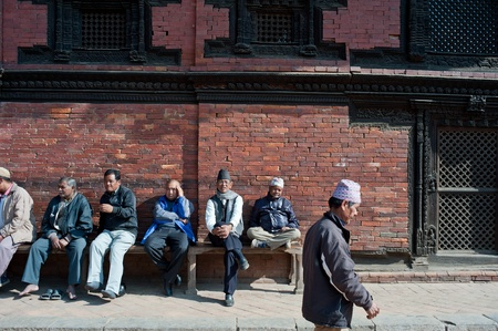 Katmandu, Nepal-January 29, 2012, : don't know the name of the nepalese who, in the temple square to have a rest, Nepal people have a deep belief in Buddhism, Kathmandu, 2012