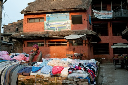 Nepal, bud hillock: on January 31, 2012, Do not know the the names of Nepal woman, in the to sell the clothing, Buddhism in Nepal, have a deep belief, 2012, bud harbor