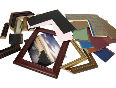 Photo pour Deciding on a framing project with an assortment of colored matboard and frame samples - path included - image libre de droit
