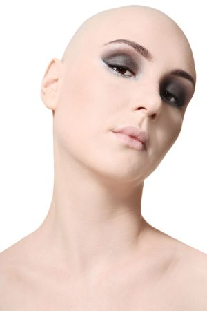 Portrait of beautiful skinhead girl with trendy makeup