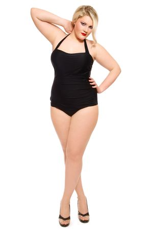Beautiful blond plus-size woman in black old-fashioned swimsuit and stilettos