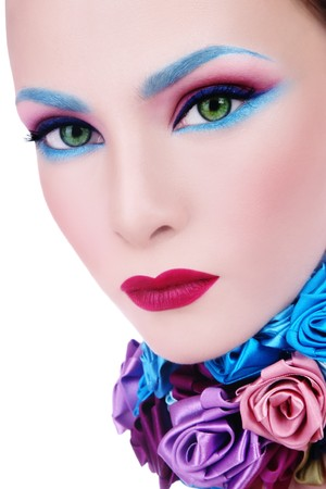 Close-up glamorous portrait of young beautiful woman with fancy blue make-up and collar of silk roses