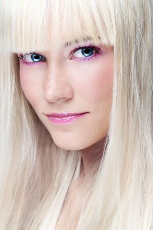 Close-up portrait of young beautiful platinum blonde girl with stylish make-up