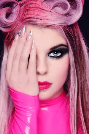 Close-up portrait of young beautiful freaky girl with fancy hairstyle and stylish makeup