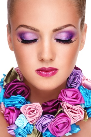 Close-up portrait of young beautiful blond girl with closed eyes and stylish violet make-up