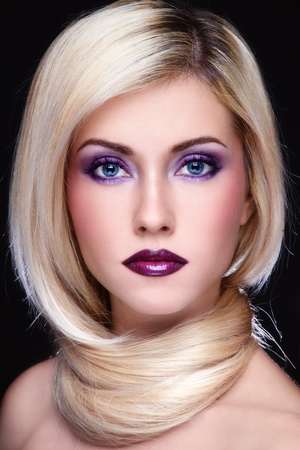 Portrait of young beautiful blond woman with stylish violet make-up