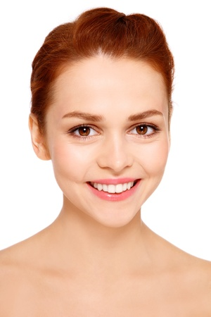 Portrait of young beautiful smiling happy woman with clear make-up on white background