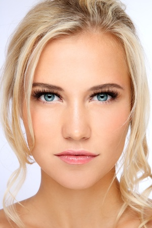 Close-up portrait of young beautiful blond girl with clear make-up