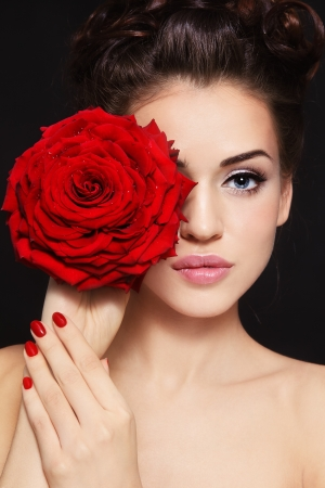 Portrait of young beautiful stylish woman with gorgeous red rose