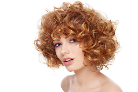 Young beautiful happy healthy woman with curly hair over white background